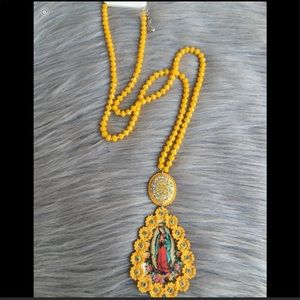 Cute yellow Virgin Mary necklace
